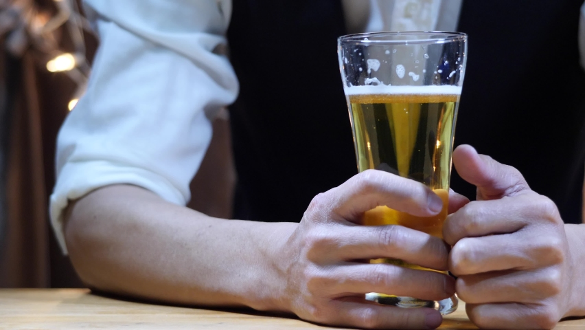 Barman pouring Beer wearing  protective mask on the bar counter    Shutterstock HD Video #1065609670