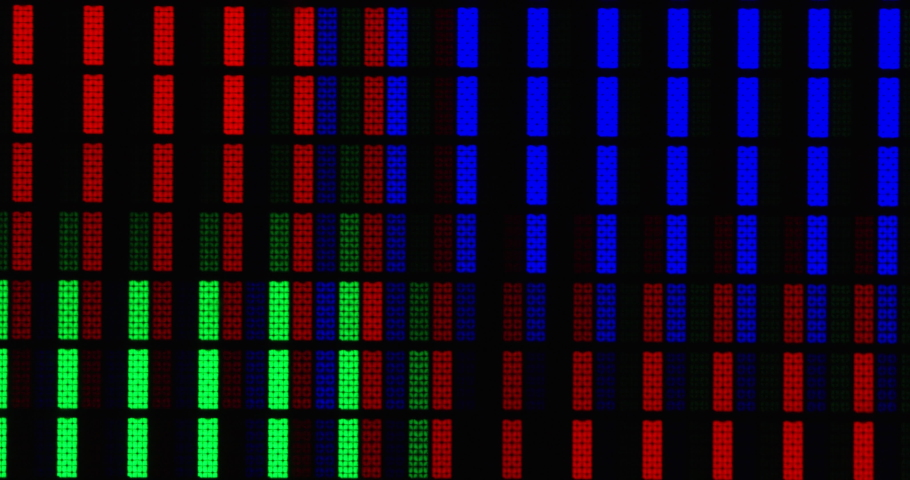 Abstract background of LCD screen. Close up computer monitor RGB pixels. Shot on RED camera. Royalty-Free Stock Footage #1065632050