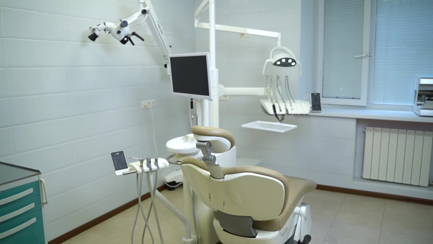 Modern interior of dentistry office with chair and tools. | Shutterstock HD Video #1065664834