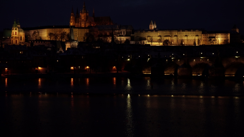 Prague Castle and the Church of St. Vitus in the center of Prague and the light from street lighting | Shutterstock HD Video #1065675040