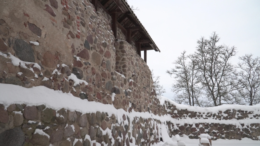 The old fortress wall of the Dobele Livonia castle stone ruins. The 13th-century national cultural monument in Latvia. A scene of the medieval palace stone building architecture. Low angle of view. | Shutterstock HD Video #1065675280