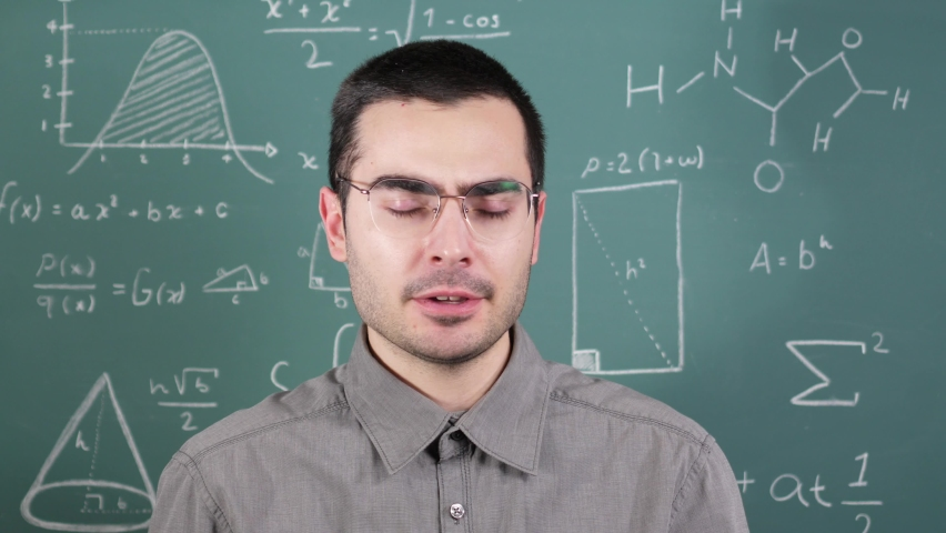 A young teacher being boring falling asleep while he is talking. | Shutterstock HD Video #1065676294