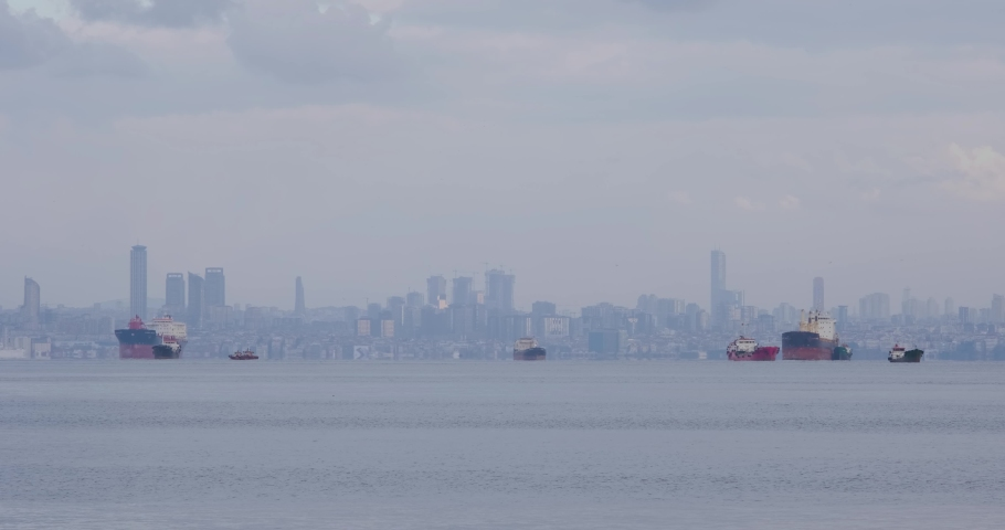 Trade ships are anchored on the sea with the view of Istanbul City | Shutterstock HD Video #1065677545