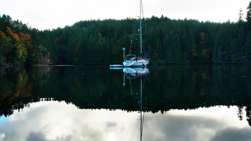 Sail Boat with Reflection on Glassy Water. | Shutterstock HD Video #1065683698