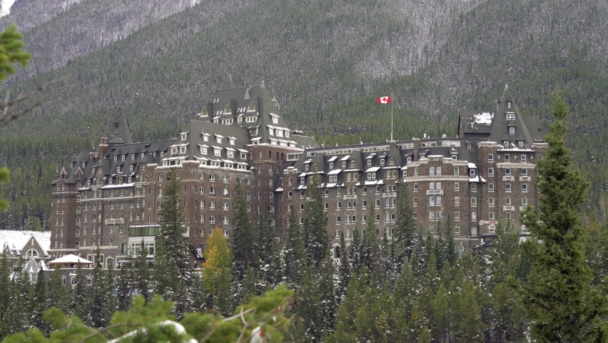 Fairmont Banff Springs in snowy autumn sunny day. View from Surprise Corner Viewpoint. Banff National Park, Canadian Rockies. | Shutterstock HD Video #1065686320
