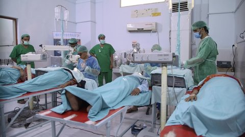 Exclusive shot shows eye surgeons, nurses and patients inside the operation room at a hospital. Taunsa, Pakistan. 26th Sept 2020