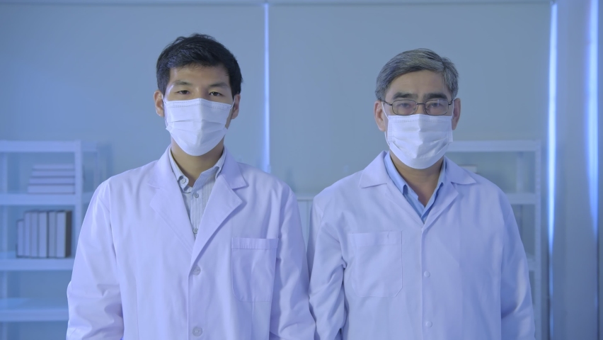 Research concept of 4k resolution. Scientists crossed their arms with confidence in the lab. | Shutterstock HD Video #1065705166