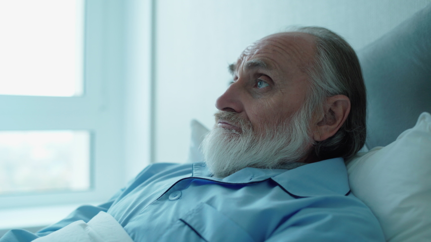 Depressed mature man lying in bed, rehabilitation in hospital, health care | Shutterstock HD Video #1065706174