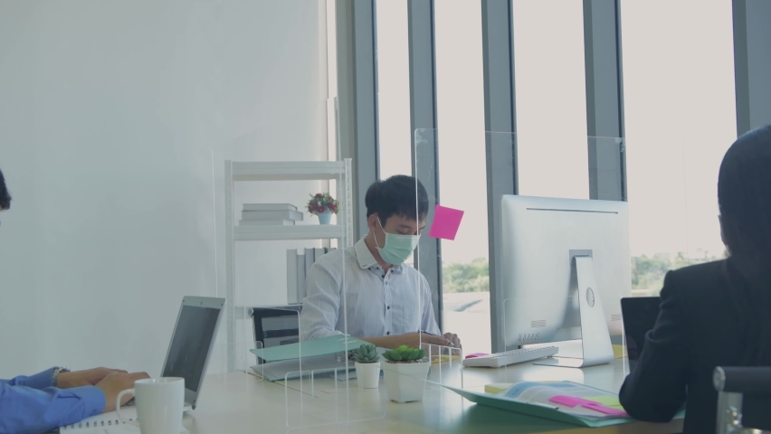 Business concept of 4k Resolution. Employees are protecting themselves while working by wearing masks. | Shutterstock HD Video #1065708820