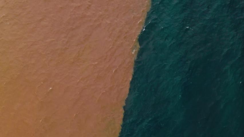 Drone aerial  of coastline in Santa Cruz de Tenerife Canary islands. Sewage pollutes the Atlantic Ocean.   Shutterstock HD Video #1065723817