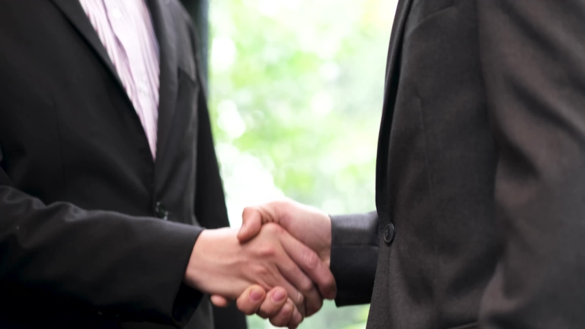 Holding hands with business partners to trust business partners, relationships to achieve future commercial and investment goals. Royalty-Free Stock Footage #1065731773