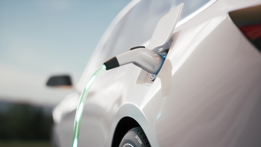 Electric car charging. Electric vehicle charging port plugging in car