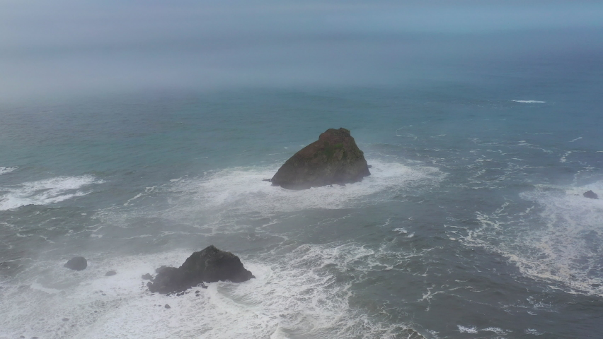 The marine layer drifts over sea stacks and the beautiful Northern California coastline in Klamath. The scenic Pacific Coast Highway runs along this amazing part of the west coast. Royalty-Free Stock Footage #1065760948