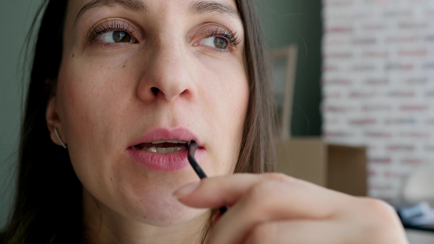 Pensive young woman working in the office looking to the side thinking about solving a problem at home office, serious woman looking for inspiration makes a decision feeling lack of ideas, close-up Royalty-Free Stock Footage #1065828442
