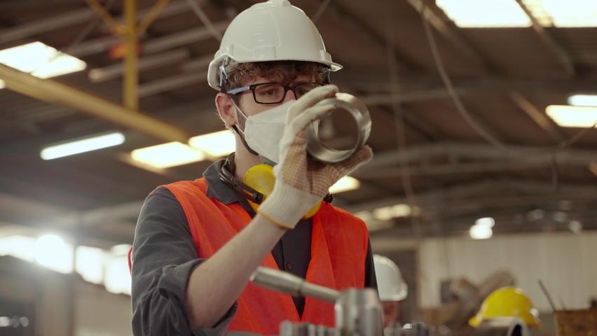 Engineers inspecting metal workpieces in the factory. Royalty-Free Stock Footage #1065829387