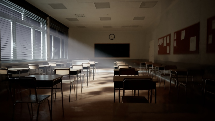 Rays of light falling to the empty dark classroom. The camera panning behind rows of desks and chairs. Teaching class without students during a break. Abandoned school. Disturbing mood. Royalty-Free Stock Footage #1065848983