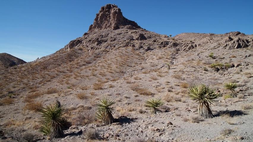 Sunny view of the beautiful landscape around Petroglyph Canyon Trail Las Vegas, Nevada | Shutterstock HD Video #1065861334