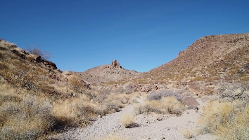 Sunny view of the beautiful landscape around Petroglyph Canyon Trail Las Vegas, Nevada | Shutterstock HD Video #1065861358