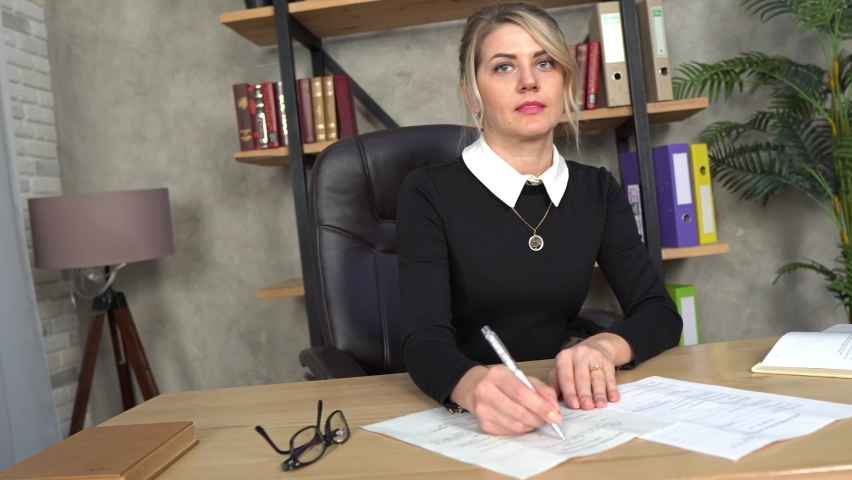 Beautiful girl works in the office, blonde in the office, office worker, works with documents, business woman, business, beautiful smile Royalty-Free Stock Footage #1065863686