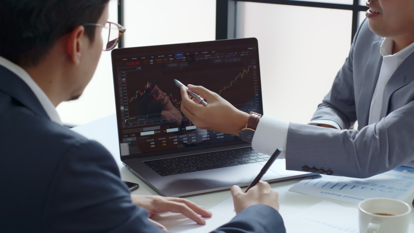 Businessman talking about investment stock market and graph from computer laptop with broker trader, giving money plan management and analysis Royalty-Free Stock Footage #1065881938