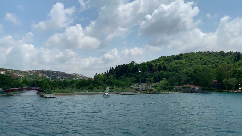 """Footage of upscale neighborhood """"Anadolu Hisari"""" by Bosphorus in Istanbul. It is a beautiful summer scene on cloudy summer day. Camera moves forward. 