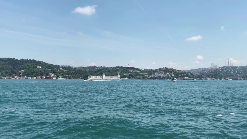 Time lapse footage of cruise tour boats and dry cargo vessel passing on Bosphorus in Istanbul. Asian side is in the view. It is a sunny summer day. | Shutterstock HD Video #1065899263
