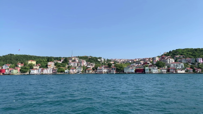 Footage of Uskudar Kuzguncuk area of Istanbul on Asian side on Bosphorus. Beautiful scene. It is a sunny summer day. Camera moves forward. | Shutterstock HD Video #1065899278