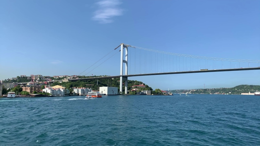 Footage of bridge, cruise tour boats and Bosphorus strait in Istanbul. Beautiful scene. It is a sunny summer day. | Shutterstock HD Video #1065899281