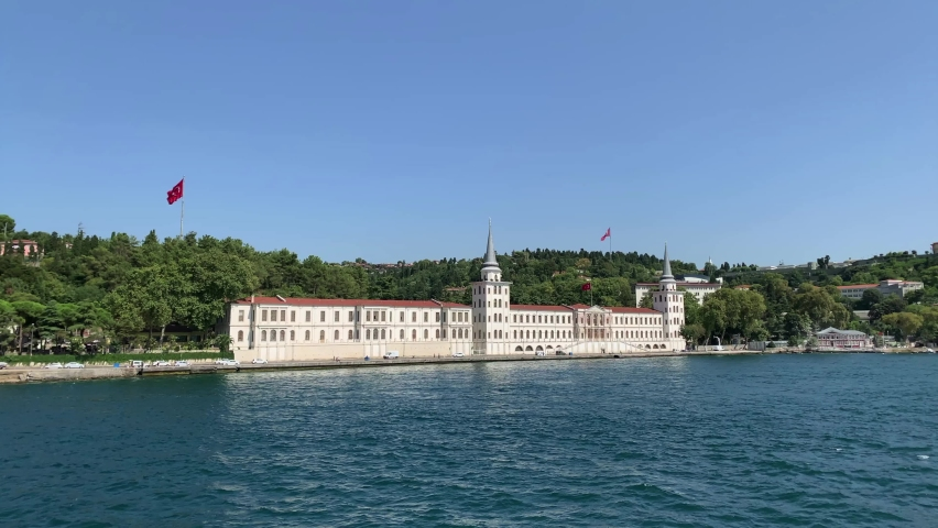 """Footage of historical military school called """"Kuleli"""" in Cengelkoy area of Istanbul on Asian side by Bosphorus strait. Beautiful scene. It is a sunny summer day. Camera moves forward. 