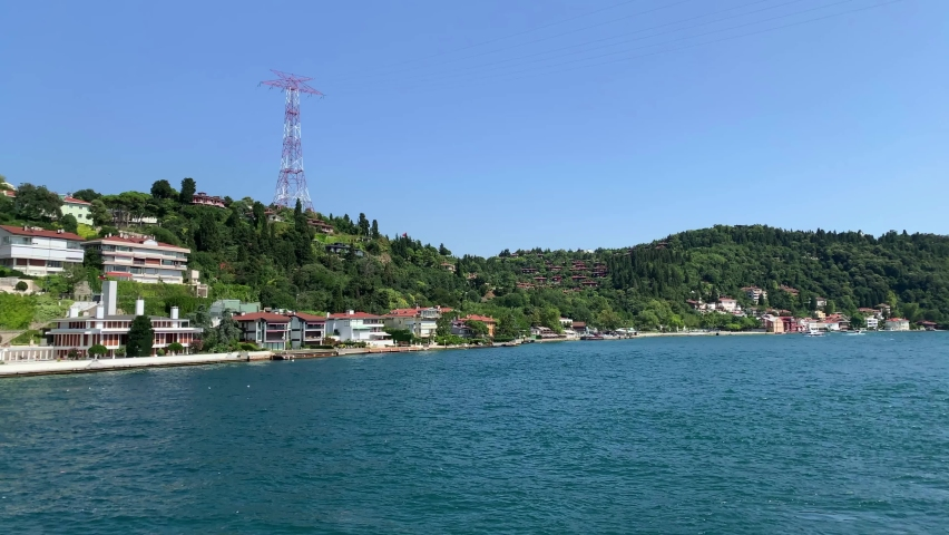 Footage of Anadolu hisari Kandilli area of Istanbul by Bosphorus. Beautiful scene. It is a sunny summer day. Camera moves forward. | Shutterstock HD Video #1065899290