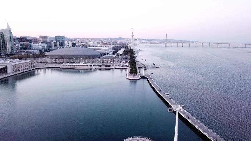 Cable way over river near Oceanarium of Lisbon. | Shutterstock HD Video #1065899722