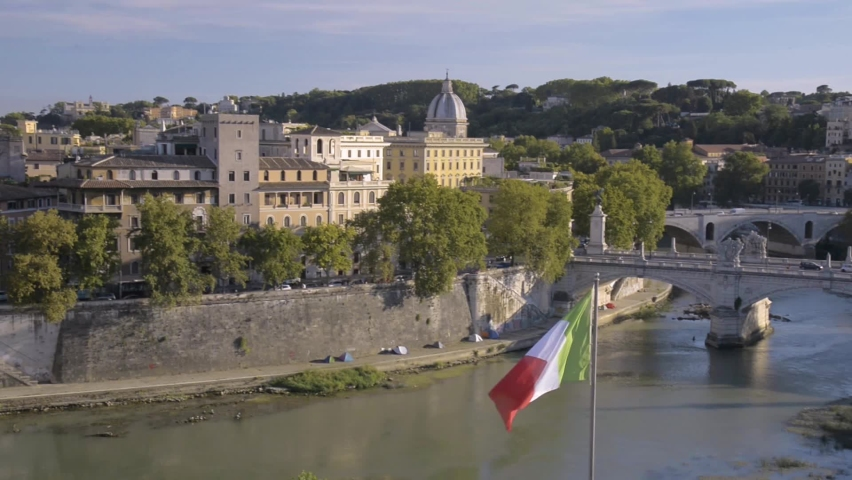 Rome, Italy, view on the Tiber, Lungotevere and Gianicolo with Waving Italian Flag in Foreground - Static Frame - 1080p 24fps | Shutterstock HD Video #1065899851