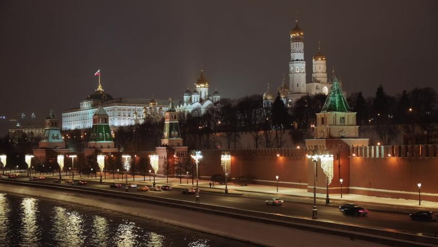 Beautiful evening shot of the Kremlin embankment and the Kremlin at winter christmas night. Cinematic 4k timelapse.  | Shutterstock HD Video #1065900160