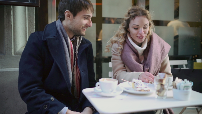Couple enjoying coffee at sidewalk cafe . Florence, Italy | Shutterstock HD Video #1065901306