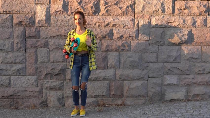 Female skateboarder dancing. Female skateboarder skateboarding at skatepark   | Shutterstock HD Video #1065901996