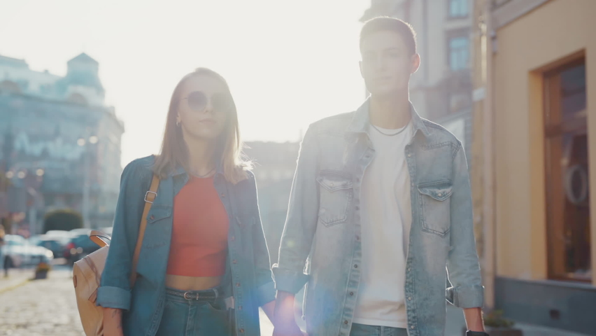 At sunlight lovely couple walking smiling look at each other feel happy at old city street. Relationship outdoors communication. Portrait. Close up. Slow motion   Shutterstock HD Video #1065936217