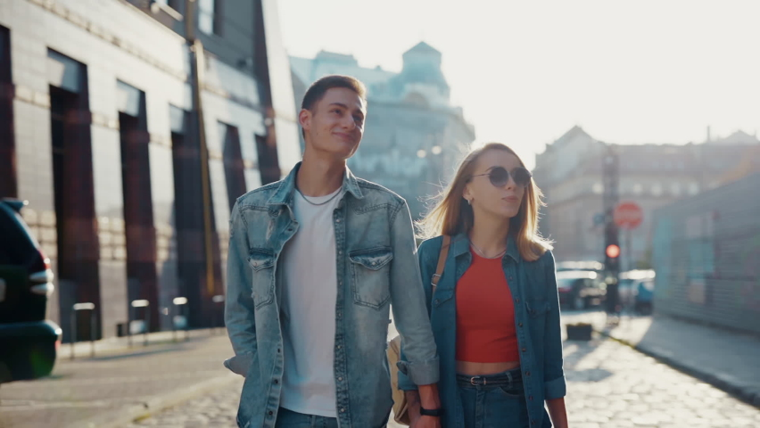 Portrait lovely couple walking smiling look at each other feel happy at old city street. Relationship outdoors communication. Close up. Slow motion   Shutterstock HD Video #1065936220
