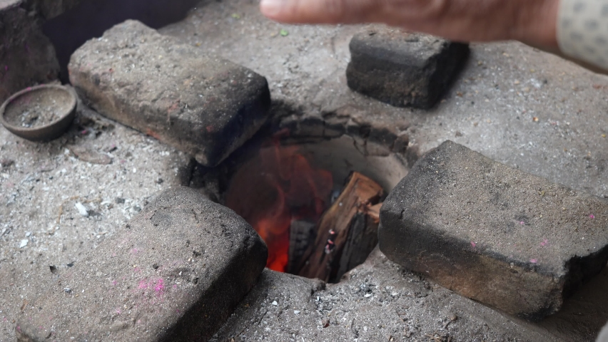 Burning charcoal fire wood in traditional Brick stove in cooking style. Slow red illuminating fire or flames in brick stove. | Shutterstock HD Video #1065945784