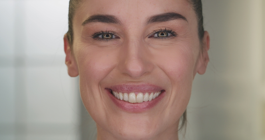 Beauty shot of mature woman face skin with imperfection before and after intensive rejuvenating anti aging treatment smiling in camera isolated on golden fond. Concept: skincare, cosmetics, healthcare