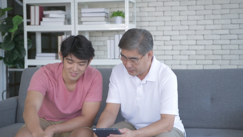 Family concept of 4k Resolution. Father and son are studying drug use information together. | Shutterstock HD Video #1065950173