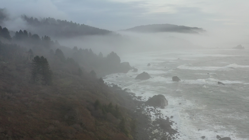 The marine layer drifts over the beautiful Northern California coastline in Klamath. The scenic Pacific Coast Highway runs along this amazing part of the west coast. Royalty-Free Stock Footage #1065950698