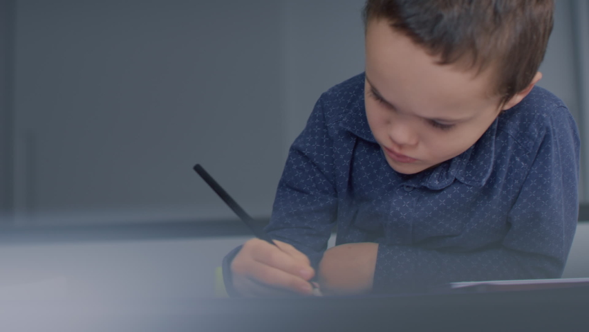 Kid colours on table, surrounded by a modern age living space. | Shutterstock HD Video #1065953632