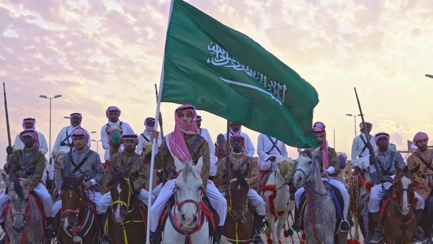Riyadh Saudi Arabia - Sep 23, 2019 A group of men wearing Saudi heritage on horses at the Saudi National Day Festival in Riyadh