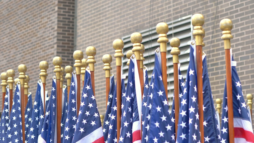 United States flags waving in New York in 4K slow motion 60fps   Shutterstock HD Video #1065959896