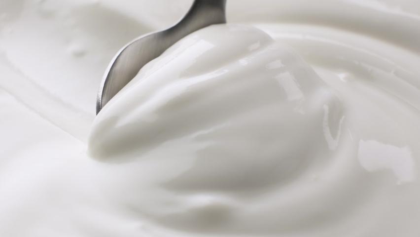 Sour cream with spoon, fresh greek yogurt close up Royalty-Free Stock Footage #1065967348