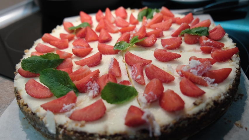 Close-up of fresh homemade cheesecake New York with strawberries and mint, 4k   Shutterstock HD Video #1065980467