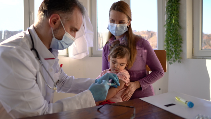 Little girl with mom, about to receive injection | Shutterstock HD Video #1065983245