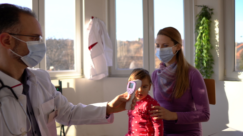 Medical doctor checking the body temperature of patient | Shutterstock HD Video #1065983257