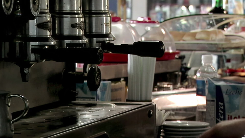Hands Of Barista Making Coffee in a Cafeteria of Buenos Aires, Argentina. Close Up. Full HD. | Shutterstock HD Video #1065983677