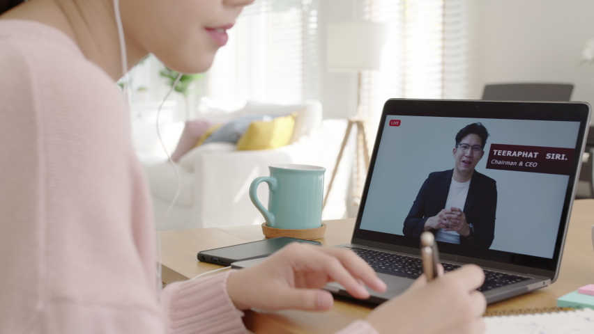 Back rear view young asian woman listen to virtual business conference webinar, management town hall or all hands meeting at home in quarantine social distance work remotely with asia speaker concept. | Shutterstock HD Video #1065983899
